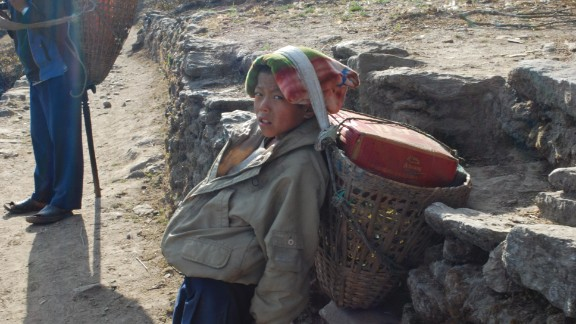 A weary child porter takes a break in Nepal's Solukhumbu district in 2010. According to statistics published by the UN Development Program, 44.2% of Nepal's population lives under the poverty line. To make ends meet, some parents send their children to work.