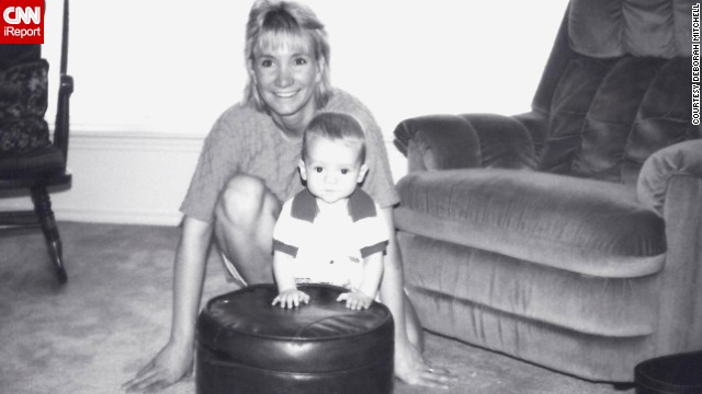 Deborah Mitchell poses with her son, Nick, when he was 6 months old.