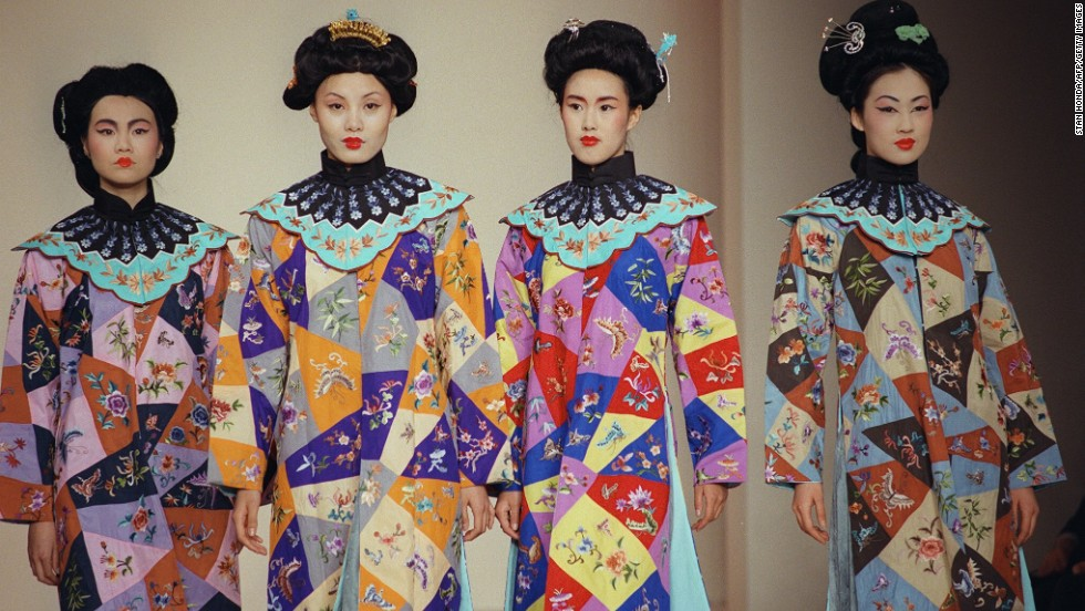 Models wear re-created robes from China's Yuan dynasty, which lasted from  A.D. 1279 to 1368. The area shares the same climate as Angkor, which collapsed about the same time.
