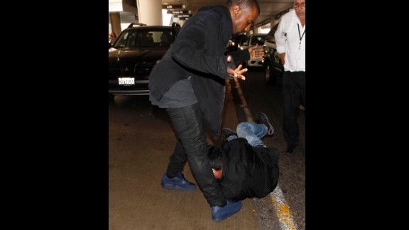 """Kanye West has turned his <a href=""""http://www.mtv.com/news/articles/1707444/kanye-west-paparazzi-rant.jhtml"""" target=""""_blank"""" target=""""_blank"""">legendary issues with the paparazzi into part of his on-stage act</a>. The rapper <a href=""""http://www.cnn.com/2009/SHOWBIZ/Music/10/23/kanye.west.hearing/index.html"""">was arrested in 2008 after a scuffle with a photog at Los Angeles International Airport</a>, and this year <a href=""""http://marquee.blogs.cnn.com/2013/06/07/kim-k-photogs-are-threatening-my-life/?iref=allsearch"""">has had repeated issues with L.A. paps</a>. The latest came in July when he got into another <a href=""""http://www.tmz.com/videos/0_yzmcgvcj#!id=0_yzmcgvcj"""" target=""""_blank"""" target=""""_blank"""">physical altercation with a paparazzo at the airport</a>."""