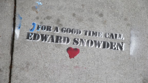 Graffiti sympathetic to Snowden is stenciled on the sidewalk in San Francisco on June 11.