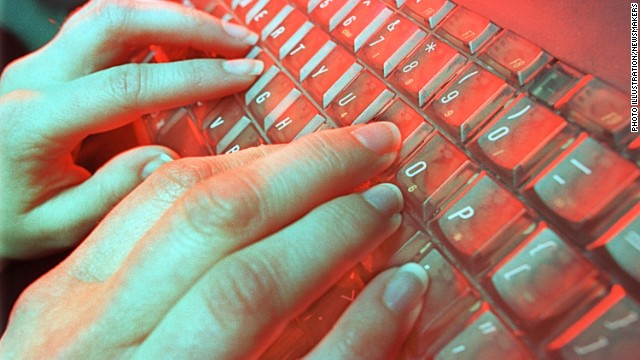 A photo illustration depicts a person typing May 4, 2001 in Denver, CO.