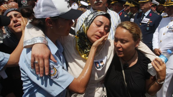"""Relatives of slain police officers are comforted during a funeral in Istanbul, Turkey, on July 10, 2008, a day after the U.S. Consulate there was attacked. Three police officers and three attackers were killed in what the American ambassador to the country called """"an obvious act of terrorism"""" aimed at the U.S."""