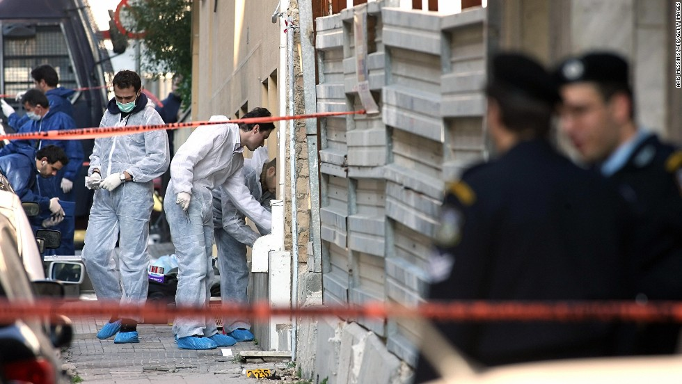 "A bomb squad team collects evidence at a construction site where a rocket was launched near the <a href=""http://www.time.com/time/world/article/0,8599,1577262,00.html#ixzz1XpywafjU"" target=""_blank"">U.S. Embassy in Athens, Greece,</a> on January 12, 2007. The anti-tank missile tore through the embassy, but there were no injuries."