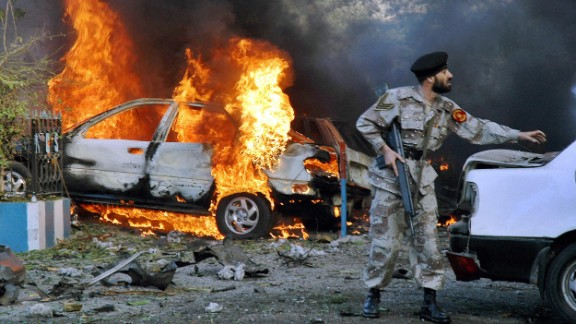 A U.S. diplomat and his driver were among at least four people killed on March 2, 2006, in an apparent suicide attack outside the U.S. Consulate in Karachi, Pakistan.