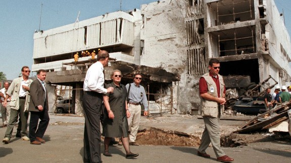 Secretary of State Madeleine Albright, center, walks past the damaged U.S. Embassy in Dar es Salaam on August 18, 1998. The August 7 attacks in Tanzania and Kenya were later attributed to al Qaeda.