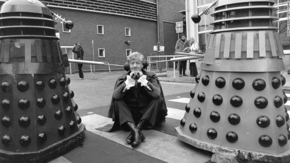 The third Doctor, played by Jon Pertwee from 1970-1974, sits in the car park of BBC Television Centre, London, guarded by two Daleks in 1972.
