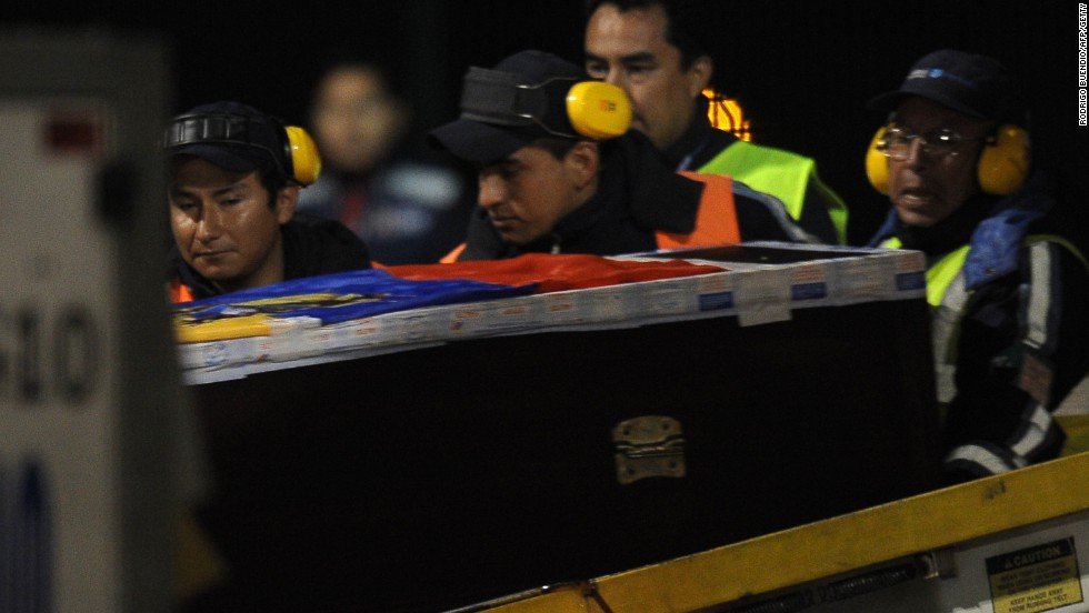 The coffin of Ecuador international Christian Benitez arrives at Mariscal Sucre airport in Quito.