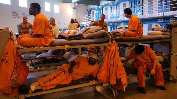 """Inmates fill a converted dayroom, which is being used as temporary """"emergency"""" sleeping area at California State Prison-Los Angeles County in Lancaster, California."""
