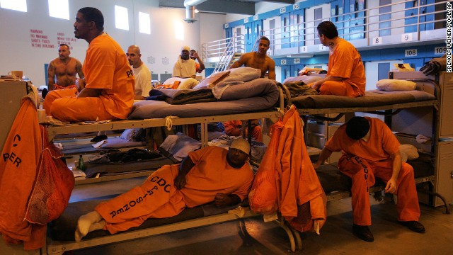 "Inmates fill a converted dayroom, which is being used as temporary ""emergency"" sleeping area at California State Prison-Los Angeles County in Lancaster, California."