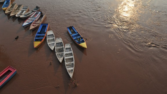A man prepares to secure his boat on the Ravi River in Lahore, Pakistan, on August 4. More than 50 people have died in flooding across Pakistan, officials say.