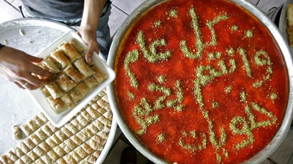 A Palestinian baker prepares baklava -- a rich, sweet treat made of layers of phyllo pastry filled with chopped nuts and sweetened with syrup or honey -- in the West Bank city of Jenin.