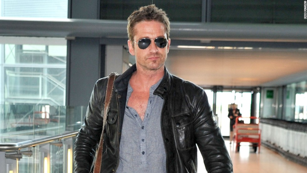 Gerard Butler flies under the radar at London's Heathrow airport on August 6.
