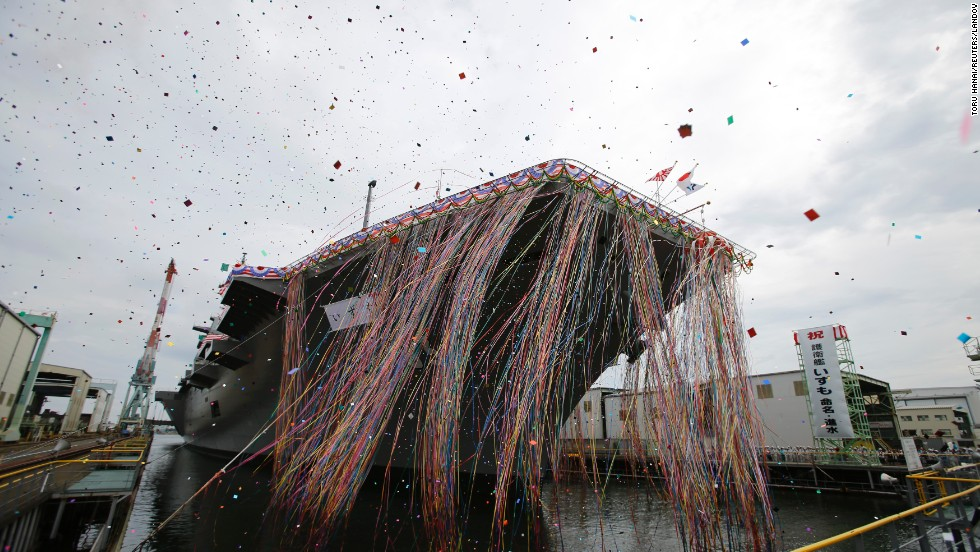 Confetti fills the air in Yokohama during the launch ceremony for the Izumo.