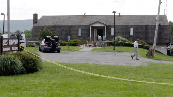 Investigators work the crime scene at the Ross Township Municipal Building on August 6, in Saylorsburg, Pennsylvania.