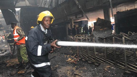 A firefighter douses a hot spot on August 7.