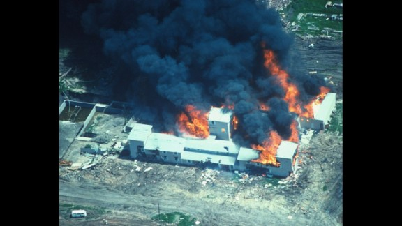 On February 28, 1993, agents of the Bureau of Alcohol, Tobacco, Firearms and Explosives tried to serve search and arrest warrants for allegedly illegal weapons at the Branch Davidian Christian compound near Waco, Texas. A gunbattle ensued followed by a seven-week standoff between church followers and FBI agents who had taken over the situation. Branch Davidian leader David Koresh refused to negotiate and when FBI forces moved in on April 19 with tear gas, a fire set the building ablaze. In total, 82 Branch Davidians, including 24 children, and four federal agents died. Above, the compound burns on April 19, 1993, after FBI agents moved in.