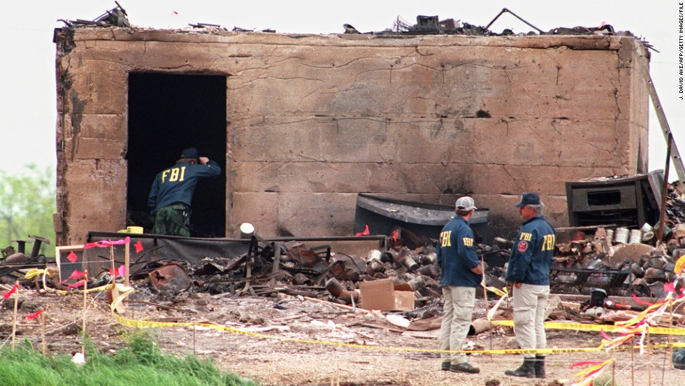 FBI agents investigate a bunker that survived the blaze that leveled the rest of the compound on April 23, 1993.
