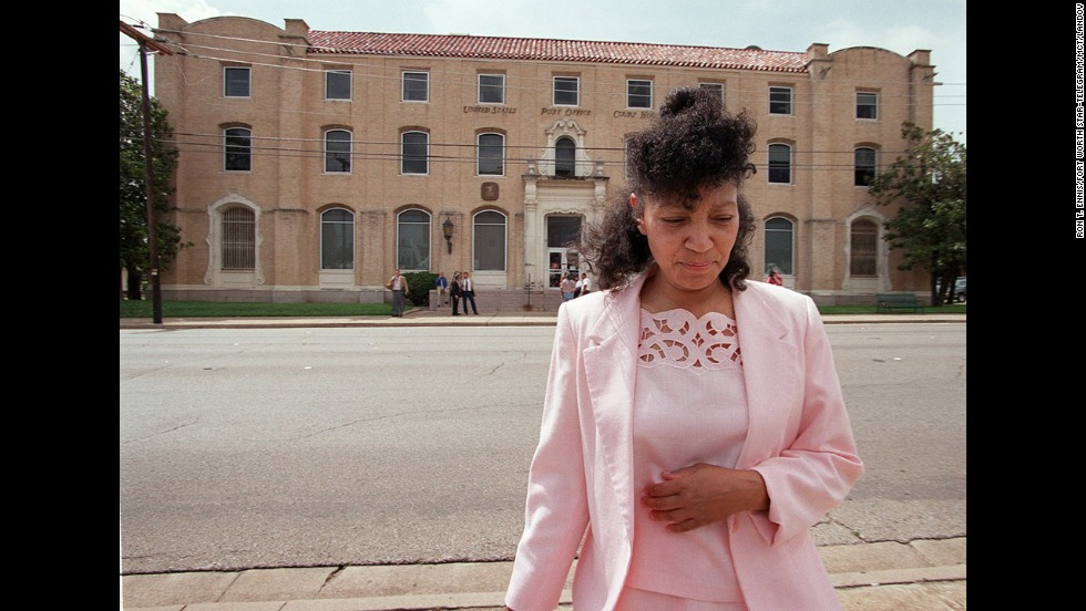 Fire survivor and Branch Davidian Sheila Martin walks away from a federal courthouse in Waco on June 19, 2000, during a break in the proceedings for a lawsuit filed against the government by survivors and family members of victims.