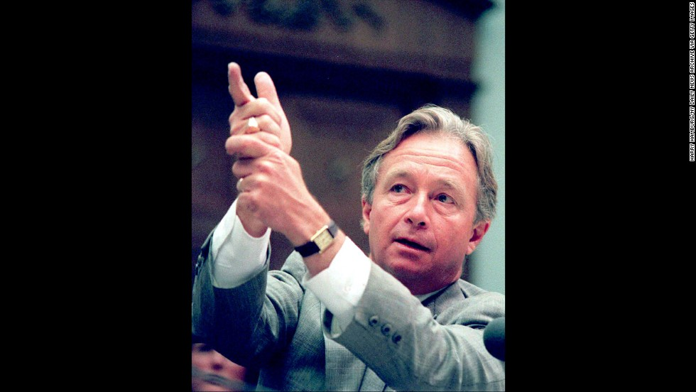 Richard DeGuerin, lawyer for the late Koresh gestures as if firing a gun during his testimony before the Congressional panel inquiry into the incident in Texas on July 25, 1995.