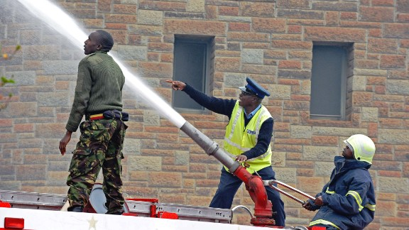 Firefighters shoot a water cannon on flames outside the Nairobi airport August 7.