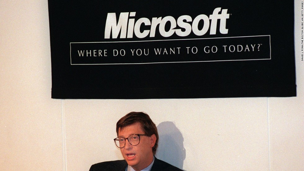 Founder Bill Gates with the Microsoft logo that was created in 1987 and is still used on some of the company's products.