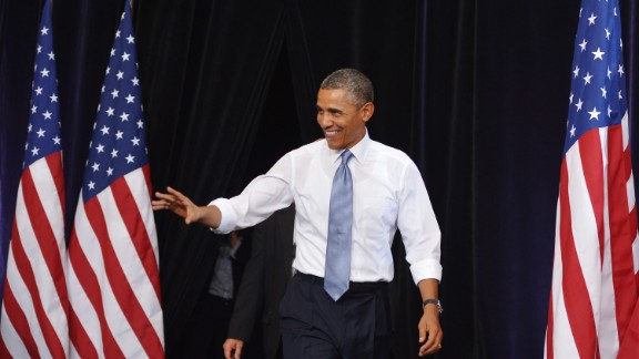 President Barack Obama arrives Tuesday at a Phoenix high school, where outside protesters used racist slogans and songs.