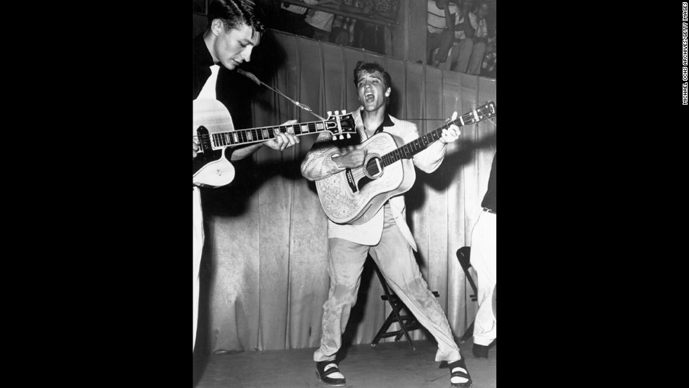 The rock 'n' roll singer performs in Tampa, Florida, with his brand new Martin D-28 acoustic guitar on July 31, 1955.