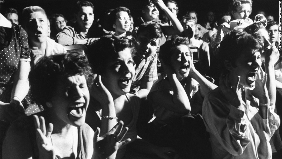 Screaming teenage girls watching Elvis in concert.