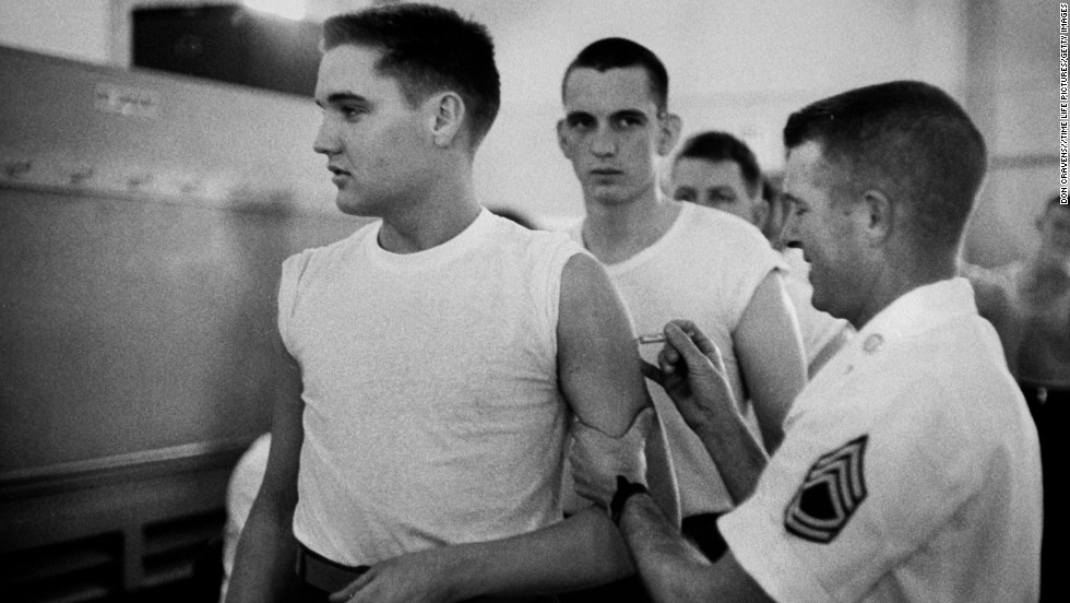 Presley, as a private in the US Army, receives a shot from at his pre-induction physical on March 26, 1958.