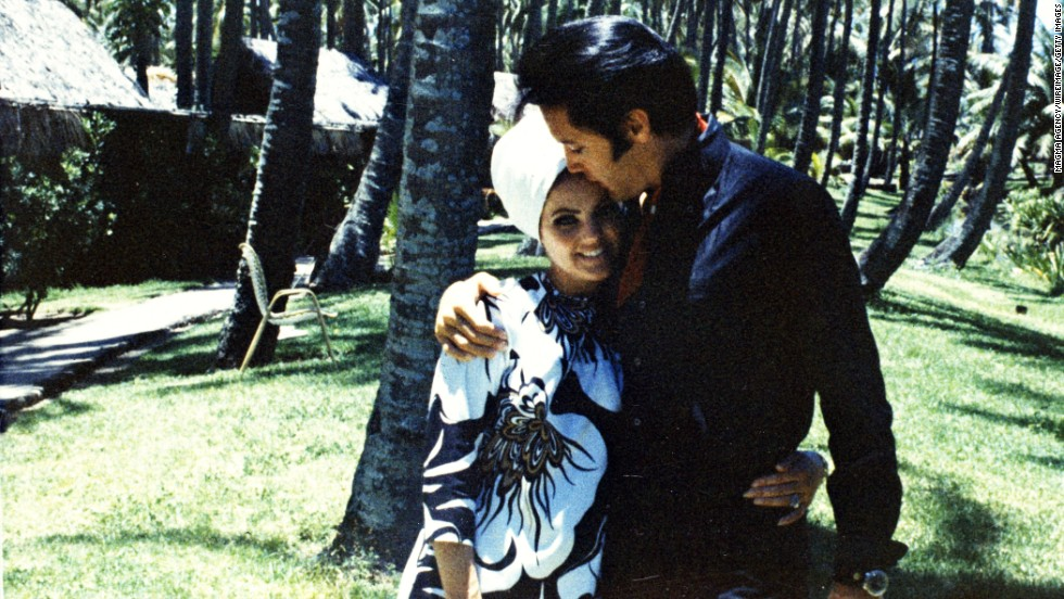 Elvis poses with then-wife Priscilla in 1968.