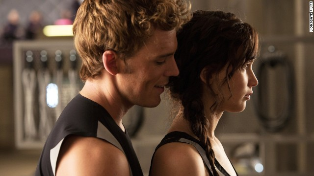 "Sam Claflin, left, co-stars with Jennifer Lawrence in the ""Hunger Games"" sequel, ""Catching Fire."""