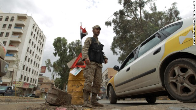 A Yemeni policeman stands at a checkpoint in Sanaa on August 3, 2013, after terror threats closed Western embassies.