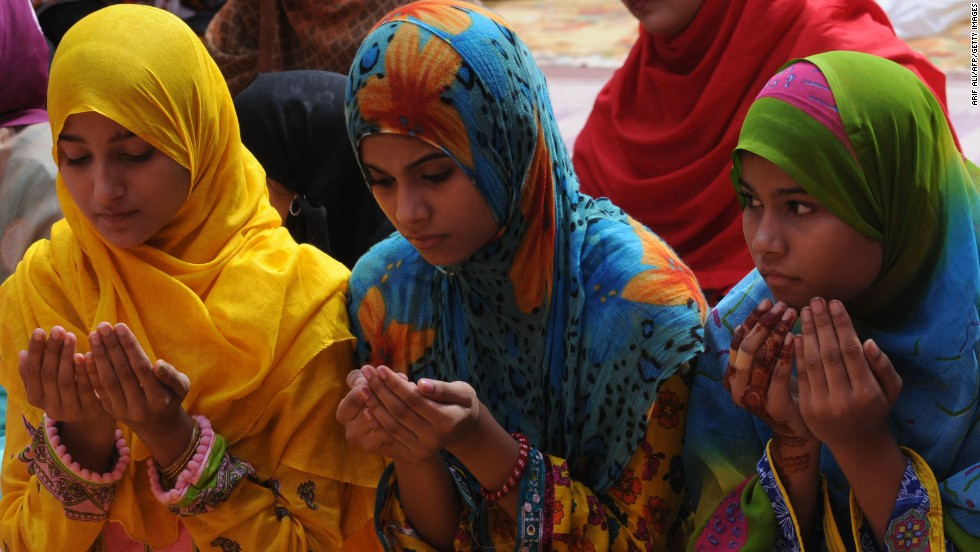 "Women pray at a Lahore, Pakistan, mosque during the first day of the <a href=""http://www.cnn.com/2013/08/09/world/the-simple-pleasures-of-eid/index.html"">Eid al-Fitr holiday</a> on Friday, August 9. Muslims around the world are celebrating Eid al-Fitr, marking the end of the fasting month of <a href=""http://www.cnn.com/2013/06/05/world/ramadan-fast-facts/index.html"">Ramadan</a>."
