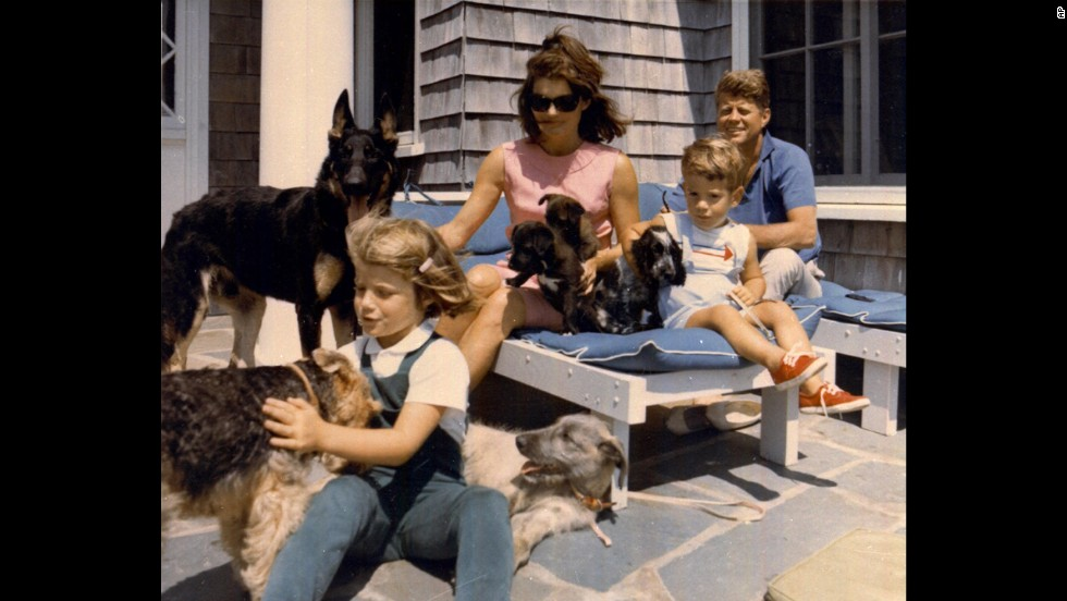 President John F. Kennedy vacations with his family in this undated photo. From left is daughter Caroline, first lady Jacqueline and son John Jr.