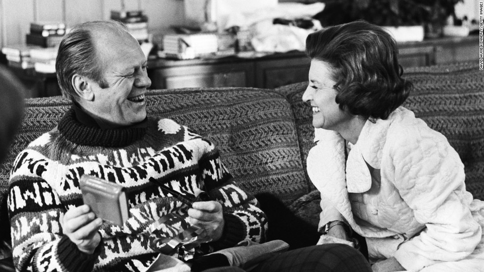 President Gerald Ford opens a gift from his wife, Betty, during their usual Christmas vacation spot in Vail, Colorado, in December 1974.