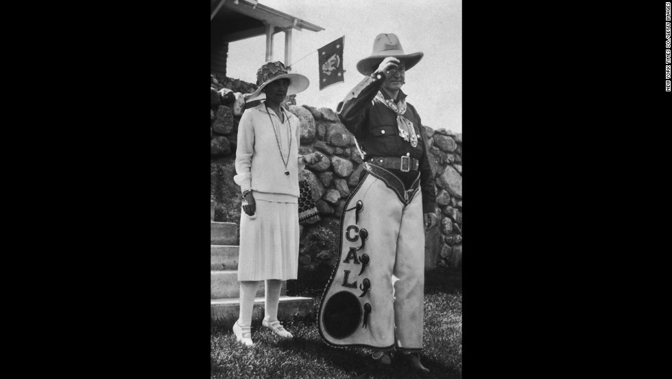 President Calvin Coolidge poses in personalized chaps with his wife, Grace, at a party in South Dakota in 1927. The party celebrated the Fourth of July as well as Coolidge's 55th birthday.