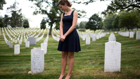 Alison Spann visits her father's grave at Arlington. (EVELIO CONTRERAS/CNN)