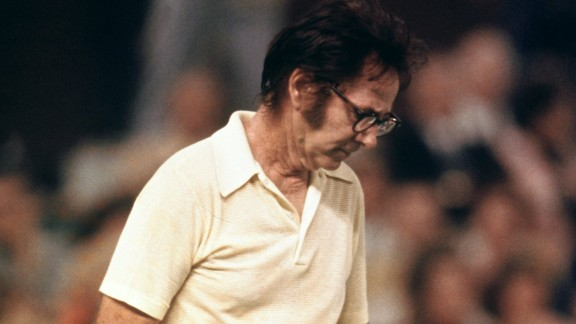 "The 55-year-old Bobby Riggs cuts a forlorn figure as he slips to defeat against King in the famous ""Battle of the Sexes"" at Houston in 1973."