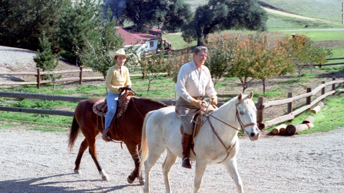 Reagan and the first lady take a horseback ride at their Rancho del Cielo vacation home in Santa Barbara, California, circa 1982.