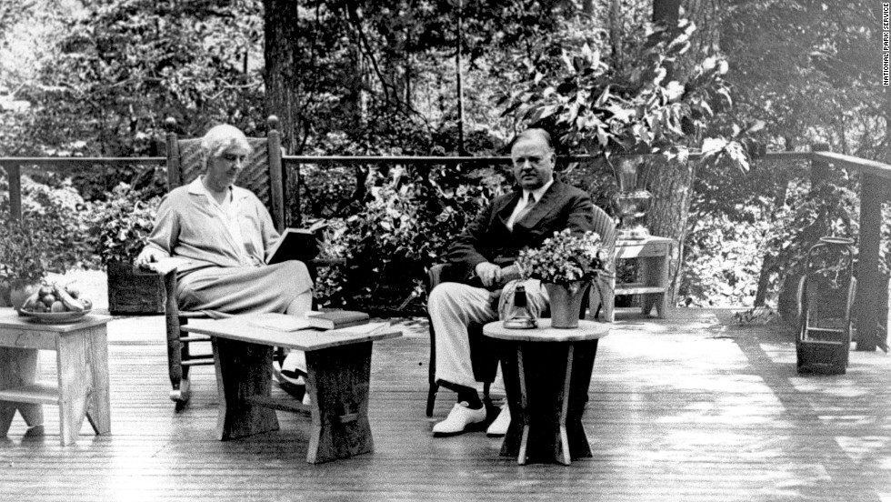 President Herbert Hoover and his wife, Lou Henry, sit on the porch of their Radipan Camp retreat, which is now part of the Shenandoah National Park in Virginia. Hoover originally bought the land for the vacation spot in 1929.