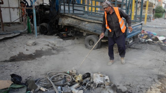 A man cleans up debris in Baghdad on August 11.