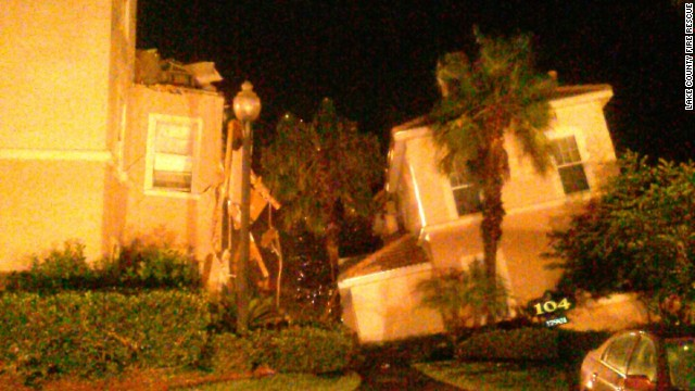 A large sinkhole formed under buildings in the Summer Bay Resort near Orlando, Florida, early Monday morning.