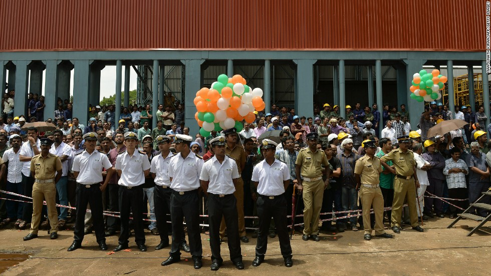 Naval officers stand during the launch of the ship at the Cochin Shipyard on August 11.