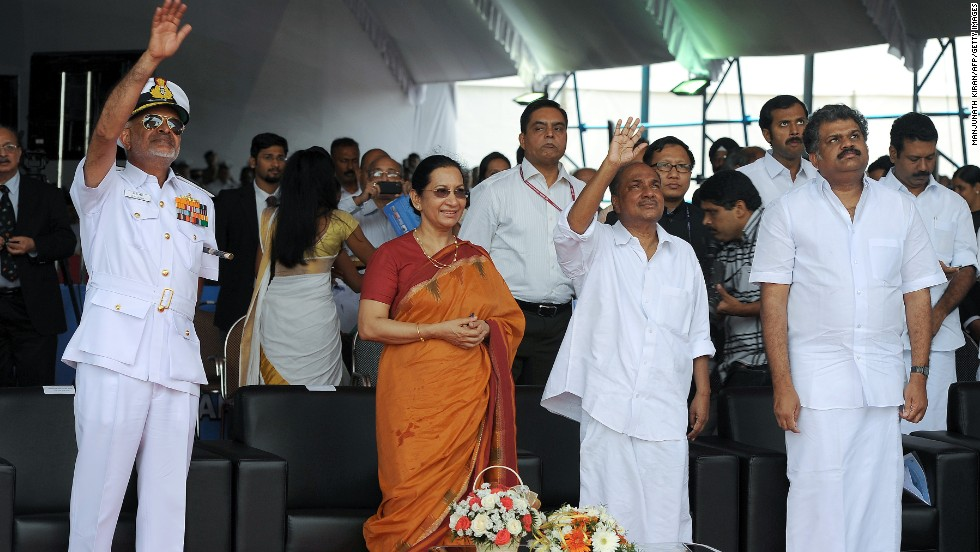 Indian Defense Minister AK Antony, second right, his wife, Elizabeth, and other officials wave after the launch of the aircraft carrier on August 12.