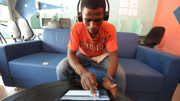 A client uses a tablet computer in the world