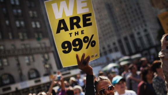 """Protesters with the """"Occupy Wall Street"""" movement demonstrate before walking up 5th Avenue to rally in front of the residence of NewsCorp CEO Rupert Murdoch in October 2011 in New York City."""