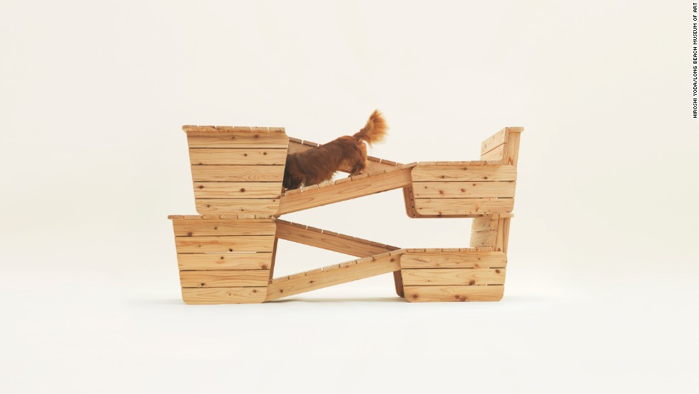 "Atelier Bow-Wow designed ""Architecture for Long-bodied, Short-Legged Dog."" The doghouse for a smooth-haired dachshund functions as lounge chairs for owner and dog, becoming a jungle gym for a curious canine when the two are stacked."
