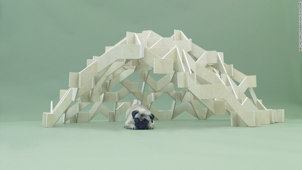 "Kengo Kuma's ""Mount Pug"" was designed for the small dog in mind. The zigzagging structure allows a playful pug to climb the doghouse from inside or out and provides a sheltered resting space for nap time."