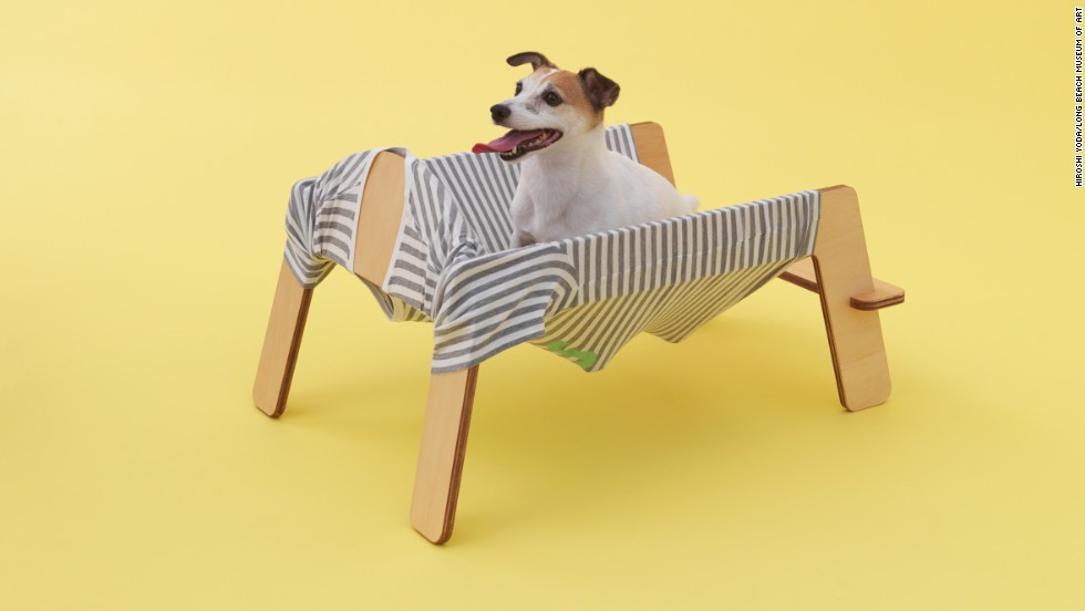 "Torafu Architects designed ""Wanmock,"" a playful combination of a hammock and a dog bark (the sound is ""wan"" in Japanese) for the energetic Jack Russell terrier. The frame is in the shape of a standing dog, and the fabric is the shape of a dog shirt."